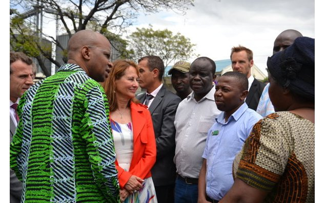 Mrs Royal with Mr January Makamba, at the charcoal sales site