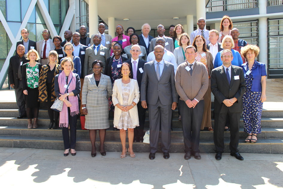 French Ambassador to Tanzania, Mrs Malika Berak (third left, front row) and EAC Secretary General Amb. Liberat Mfumukeko (third right, front row) with in a group photo with other participants at the regional seminar on exchanges between the EAC and the Francophone world outside the EAC Headquarters in Arusha - JPEG